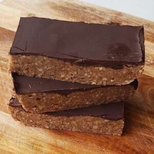 Paleo Protein Bars in a tack on wooden board