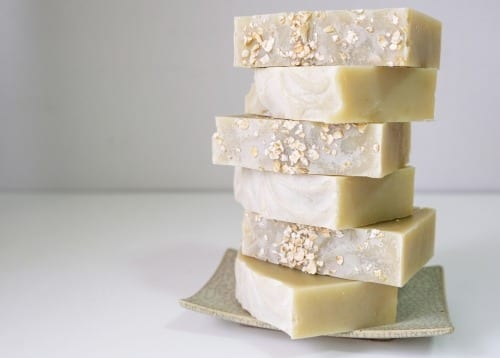 Natural oatmeal soap is placed on a white background.