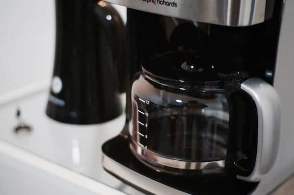 silver and black coffee machine