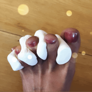 painted toes with marshmallows as toe separators