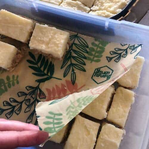 lemon coconut slice in container with honey wrap
