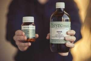 bottles of medicinal kava being held