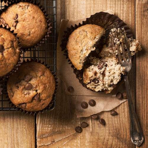 Banana chocolate chip muffins on cooking rack